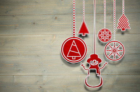 bleached: Hanging christmas decorations against bleached wooden planks background Stock Photo