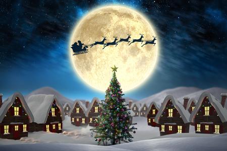 青のオーロラ夜空に対してかわいいクリスマスの村 写真素材