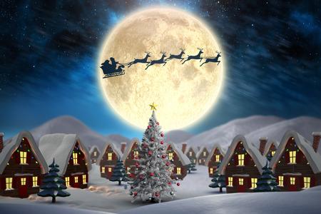 Cute christmas village against aurora night sky in blue Foto de archivo