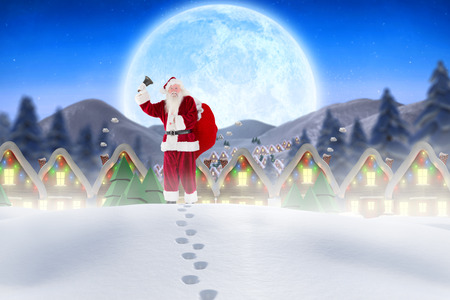 Santa walking in the snow against quaint town with bright moon photo