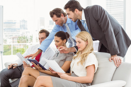 Young business colleagues in meeting at office Stock Photo