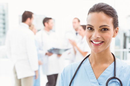 Close up portrait of a smiling confident female doctor at medical office photo