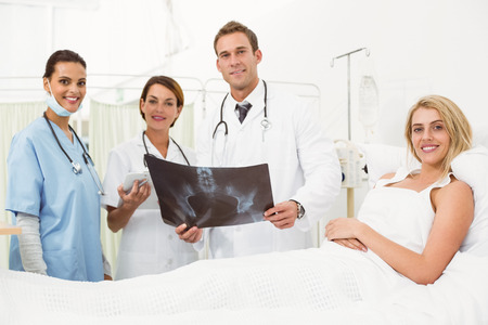 Portrait of doctors and patient with x-ray in the hospital photo