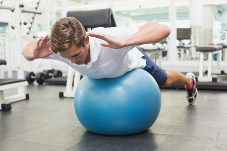 plank position: Man in plank position on exercise ball at the gym Stock Photo
