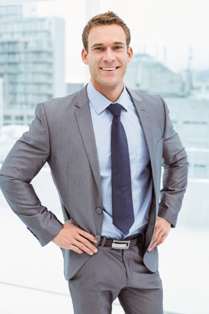 suit man: Portrait of smart young businessman in suit at office Stock Photo