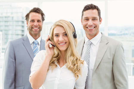 Portrait of happy young business people standing in the office photo