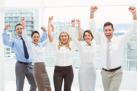 Portrait of cheerful business people cheering in the office photo