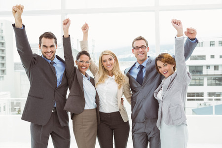 happy business man: Portrait of cheerful business people cheering in the office