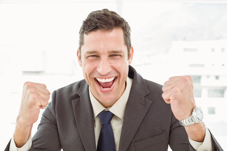 Close up of cheerful businessman cheering in the office photo