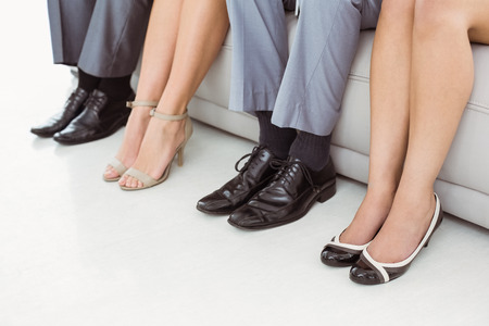 Low section of business people waiting for job interview photo