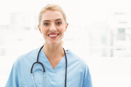 Portrait of a smiling confident female doctor at medical office photo