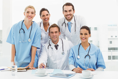 Male and female doctors working on reports in medical office photo