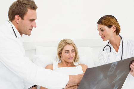Male doctor explaining x-ray to patient in the hospital photo
