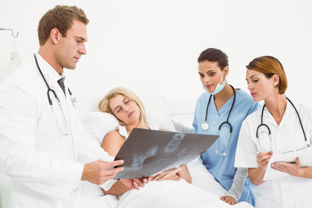 Doctors explaining x-ray to patient in the hospital photo