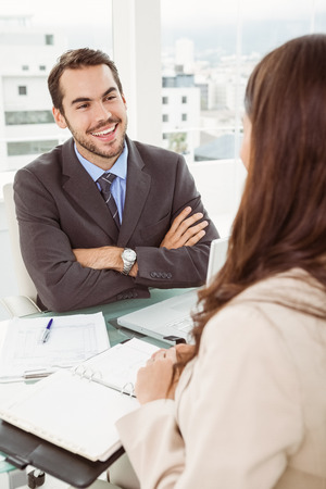 Young businessman interviewing woman in the office photo