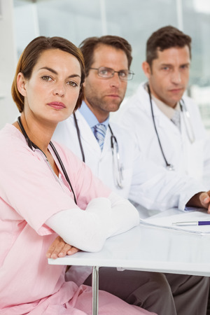 Portrait of confident doctors at desk in the medical office photo