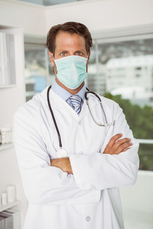 Portrait of a male doctor wearing surgical mask in the hospital photo
