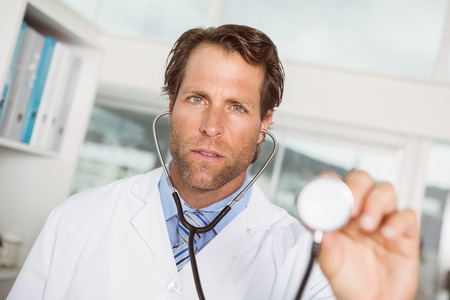 Portrait of male doctor with stethoscope in the hospital photo