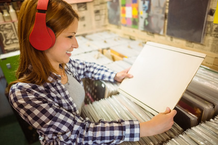record shop: Pretty redhead searching a vinyl in the store