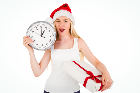 Festive blonde holding a clock and gift on white background photo