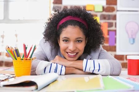 interior designer: Portrait of smiling female interior designer sitting at office desk