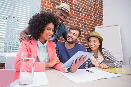 brick walls: Creative business team using digital tablet in meeting at office