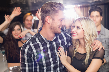 dancing club: Stylish couple smiling and dancing together at the bar
