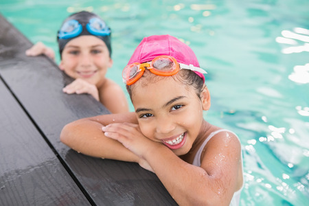 swimming goggles: Cute swimming class in the pool at the leisure center Stock Photo