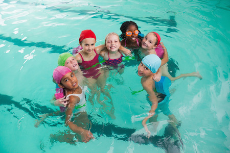 sport and leisure: Cute little kids in the swimming pool at the leisure center