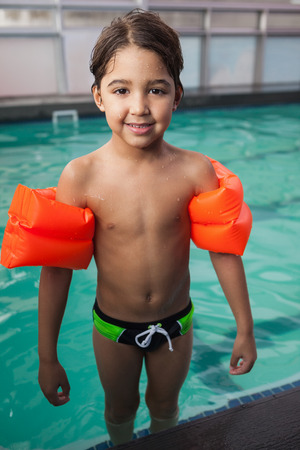 armbands: Little boy smiling at the pool at the leisure center