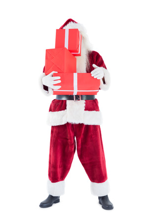 Santa covers his face with presents photo
