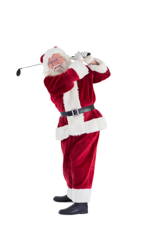 christmas golf: Santa Claus swings his golf club on white background