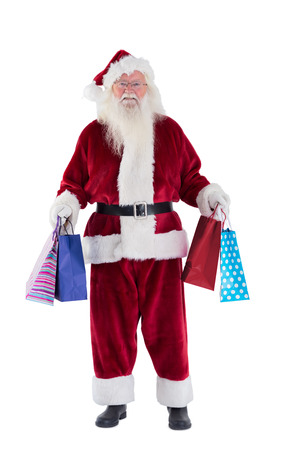 Santa carries some Christmas bags on white background photo