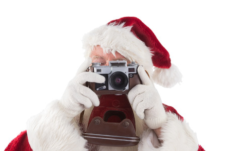 take time out: Santa is taking a picture on white background Stock Photo