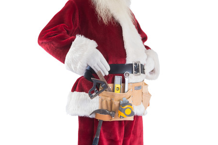 pere noel: Father Christmas is wearing a tool belt on white background Banque d'images