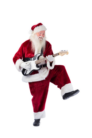 Santa Claus has fun with a guitar on white background