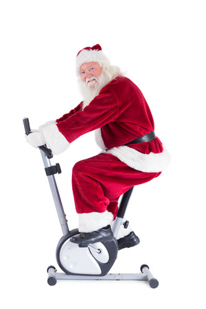 home trainer: Santa uses a home trainer on white background