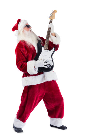 Santa Claus plays guitar with sunglasses on white background