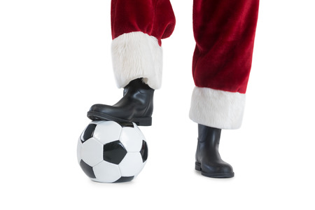 football boots: Santa Claus is playing soccer on white background