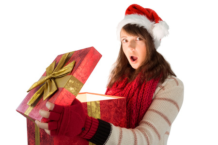 Young woman opening a glowing christmas gift on white background photo
