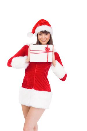 Sexy santa girl holding gift on white background photo
