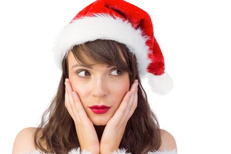 pere noel sexy: Jolie fille p�re avec les mains sur le visage sur fond blanc Banque d'images