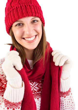 warm clothing: Portrait of a brunette in warm clothing on white background