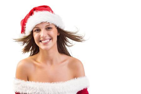 pere noel sexy: Femme en chapeau de P�re No�l avec des cheveux dans le vent sur fond blanc Banque d'images