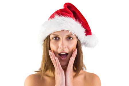 pere noel sexy: Surpris brune � santa tenue sur fond blanc Banque d'images