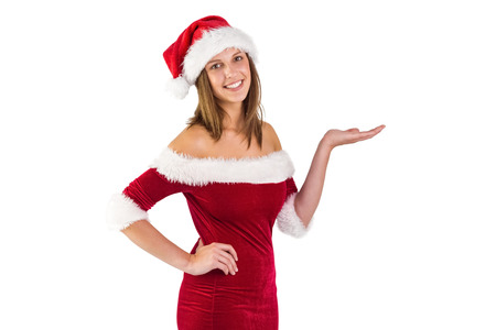 pere noel sexy: Jolie Santa Girl souriant � la cam�ra et pr�sentant sur fond blanc Banque d'images