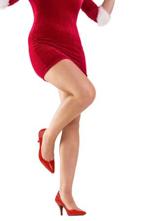 pere noel sexy: La moiti� inf�rieure de p�re no�l sexy fille sur fond blanc Banque d'images