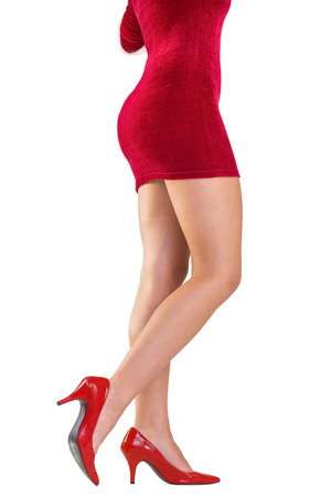 pere noel sexy: Festive womans legs in high heels on white background Banque d'images