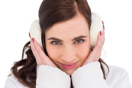 ear muffs: Pretty brunette with ear muffs on white background