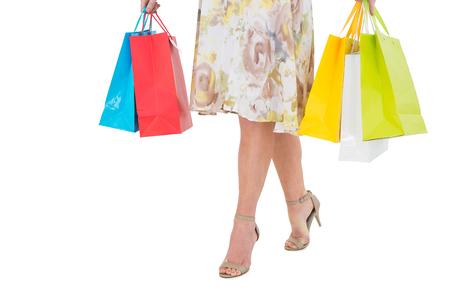 gift spending: Elegant woman holding shopping bag on white background Stock Photo